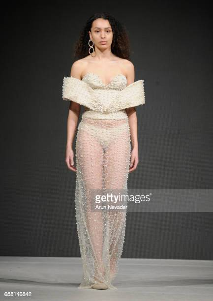 A model walks the runway wearing Viviane Valerlus at Vancouver Fashion Week Fall/Winter 2017 at Chinese Cultural Centre of Greater Vancouver on March...