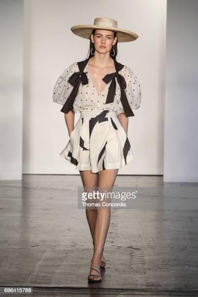 A model walks the runway wearing Zimmermann Resort 2018 at Industria Studios on June 15 2017 in New York City