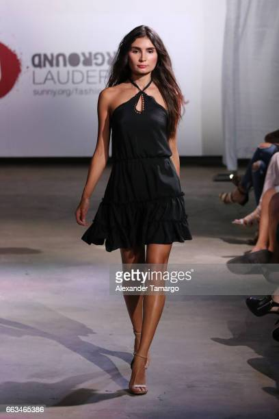 A model walks the runway wearing Zoey Riva at Underground Lauderdale Fashion Weekend Brought To You By The Greater Fort Lauderdale Conventions...