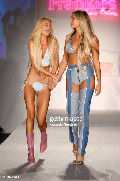A model walks the runway with designer Francesca Aiello during the SWIMMIAMI Frankie's Bikinis 2018 Collection fashion show at the SWIMMIAMI tent on...