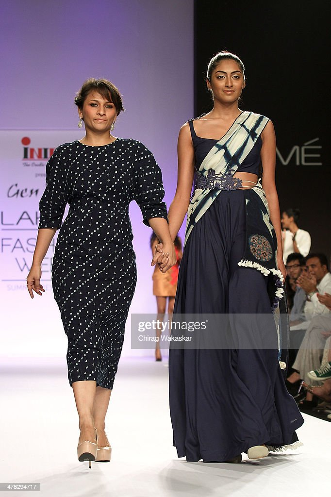 A model walks the runway with Divya Sheth (L) at day 2 of Lakme Fashion Week Summer/Resort 2014 at the Grand Hyatt on March 12, 2014 in Mumbai, India.