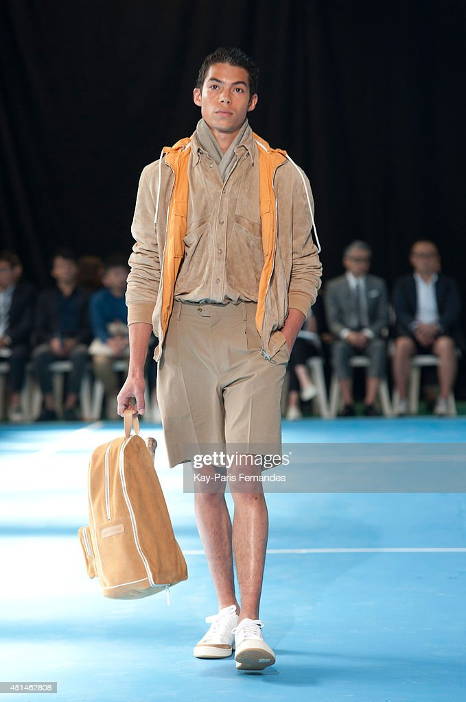 A model walks the runway with during the Umit Benan as part of the Paris Fashion Week Menswear Spring/Summer 2015 on June 29, 2014 in Paris, France.