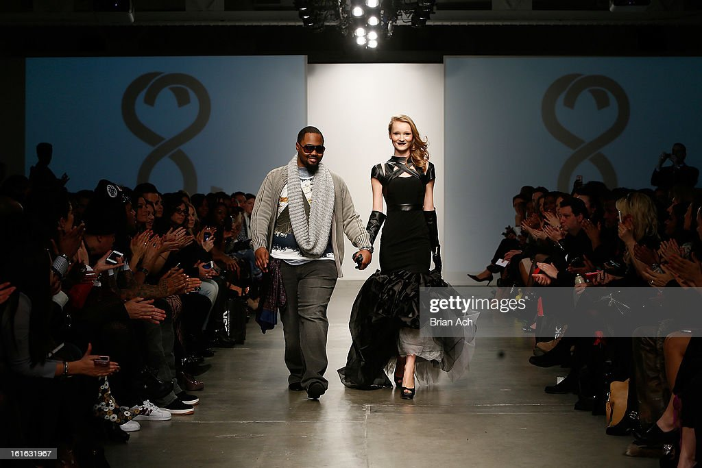 A model walks the runway with fashion designer Stephen Goudeau (L) at the Studio 6th Sense show during Nolcha Fashion Week New York 2013 presented by RUSK at Pier 59 Studios on February 13, 2013 in New York City.