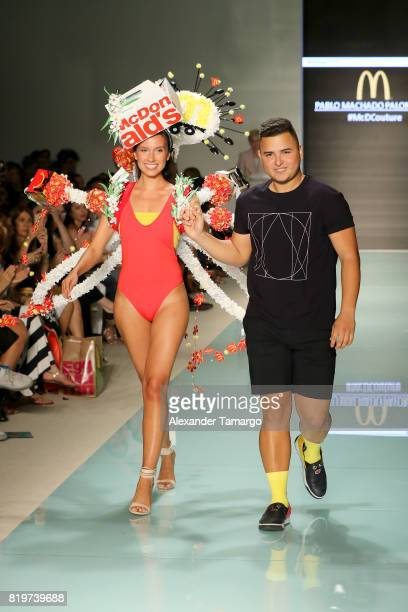 A model walks the runway with Miami international University of Art and Design Fashion Student Pablo Machado Palomeque winner of the McDCouture...