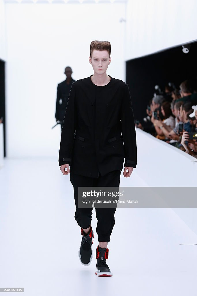A model walks the runway with the NOCI 003 shoes during the Y-3 SS17 Paris Fashion Week Show on June 26, 2016 in Paris, France.