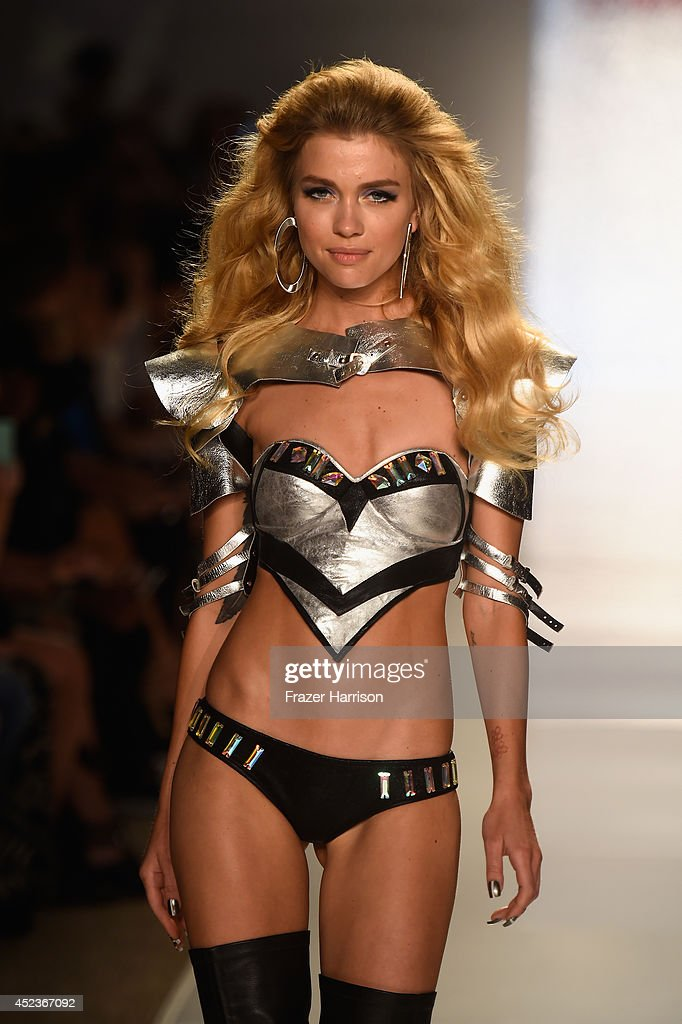 A model walks the runway with TRESemme at the Beach Bunny Featuring The Blonds show during MercedesBenz Fashion Week Swim 2015 at Cabana Grande at...