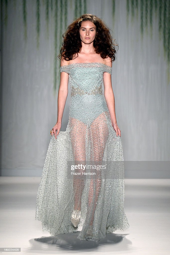 A model walks the runway with TRESemme at the Jenny Packham fashion show during Mercedes-Benz Fashion Week Spring 2014 at The Studio at Lincoln Center on September 10, 2013 in New York City.