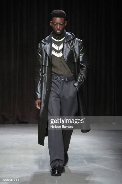 A model walks the ruway at the Boss fashion show during NYFW Men's at Skylight Modern on January 31 2017 in New York City