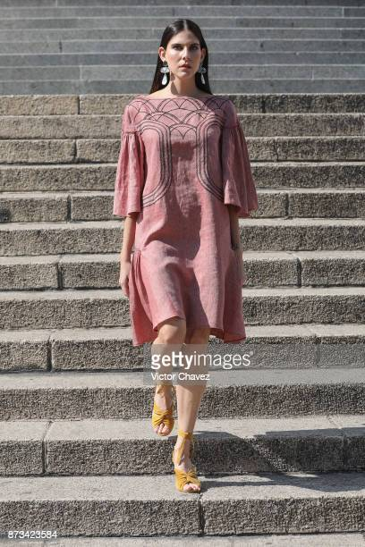 A model walks the stairs during the Yakampot show at Mercedes Benz Fashion Week Mexico Spring/Summer 2018 at Angel De La Independencia on November 12...