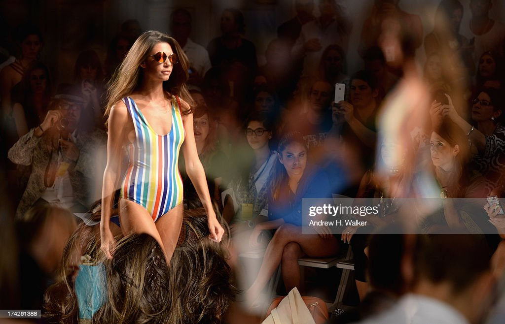 A model wals the runway at the Anna Kosturova/Beach Riot/Lolli Swim/Manglar/Indah show during Mercedes-Benz Fashion Week Swim 2014 at the Raleigh on July 22, 2013 in Miami Beach, Florida.
