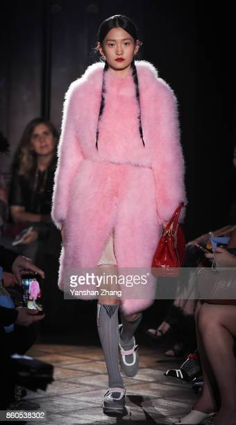 Model Wang Xinyu walks the runway during Prada 2018 Resort Fashion Show at Prada Rong Zhai on October 12 2017 in Shanghai China