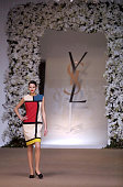 A model waring a 'Mondrian dress' walks the runway during Yves Saint Laurent Springsummer 2002 haute couture collections on January 23 2002 in Paris...