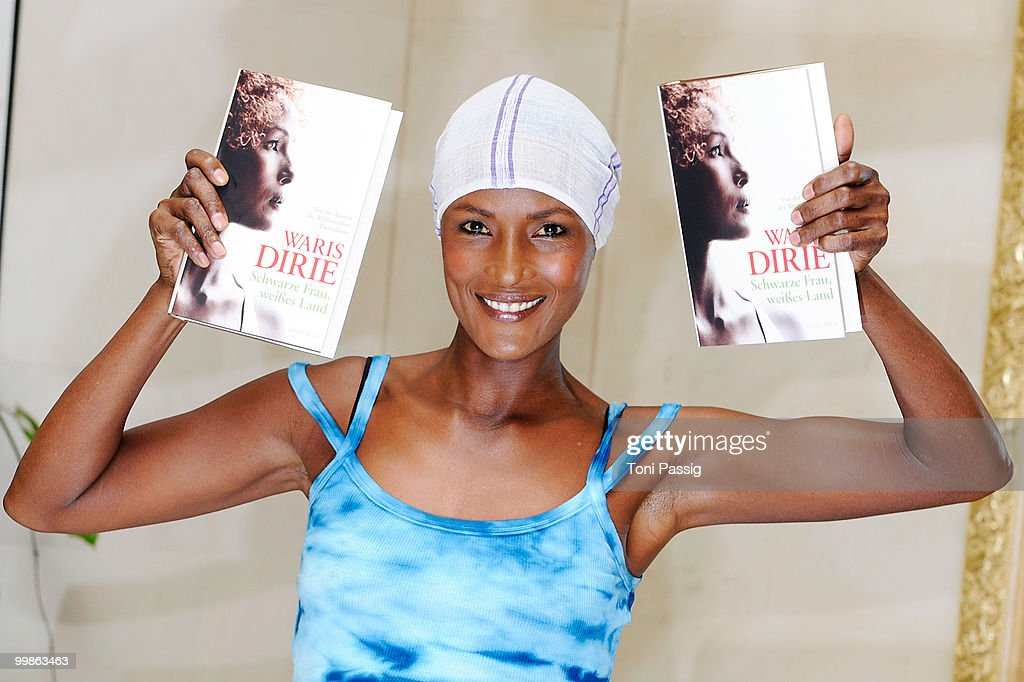 Model <a gi-track='captionPersonalityLinkClicked' href=/galleries/search?phrase=Waris+Dirie&family=editorial&specificpeople=2366489 ng-click='$event.stopPropagation()'>Waris Dirie</a> presents her new book 'Schwarze Frau, Weisses Land' at Hotel Adlon on May 18, 2010 in Berlin, Germany.