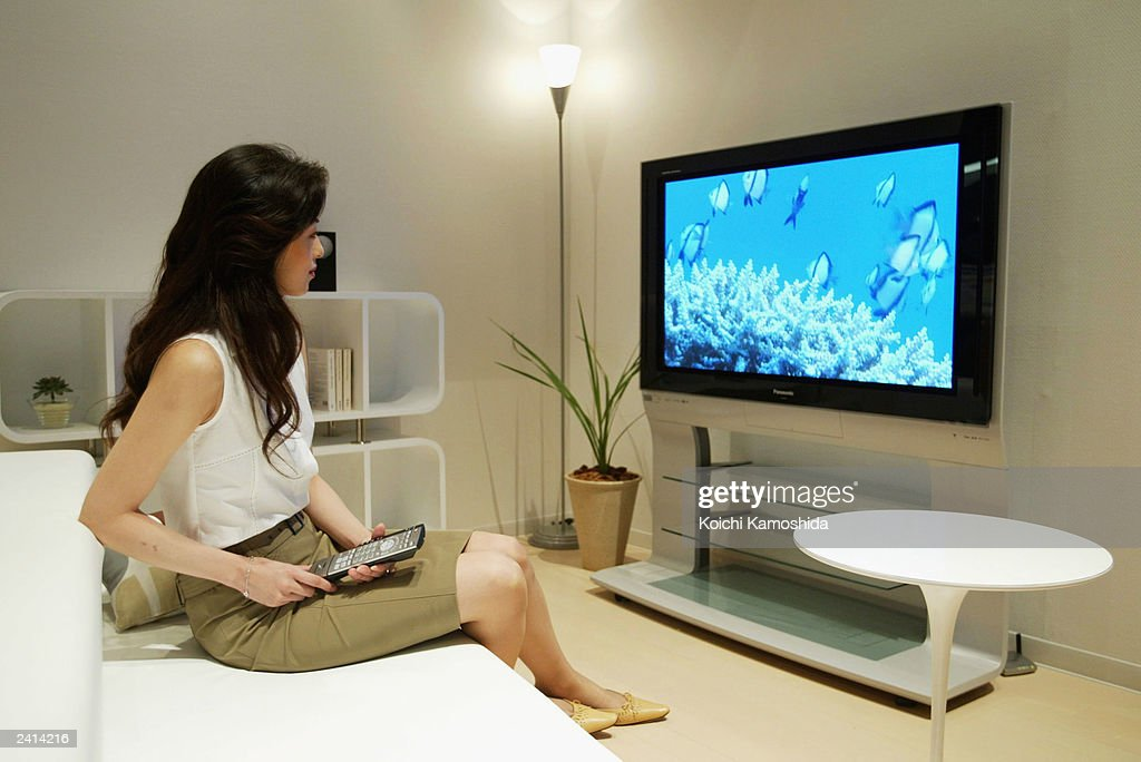 A model watches a 50inch plasma screen made by Panasonic part of the Matsushita Electric Industrial Co Ltd August 21 2003 in Tokyo Panasonic...