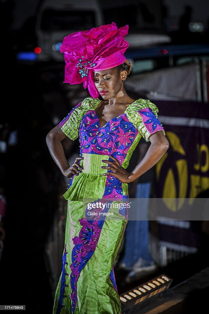 A model wearing a Barra Couture design at the Dakar Fashion Week on June 21, 2013, in Dakar, Senegal. Day three of the Dakar Fashion Week 2013 saw the first fashion show with the collection of Adama Paris, Virginie Ayissi, Bibas and Evgheni.