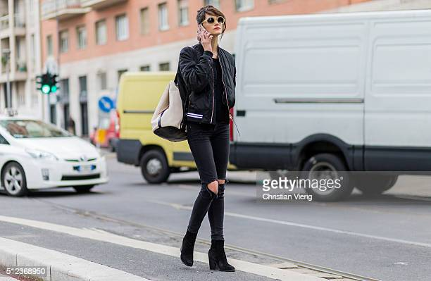 A model wearing a black bomber jacket and black ripped denim jeans seen outside Costume National during Milan Fashion Week Fall/Winter 2016/17 on...