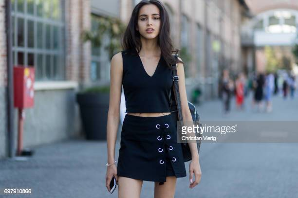 A model wearing a black skirt black top is seen outside Malibu 1992 during Milan Men's Fashion Week Spring/Summer 2018 on June 19 2017 in Milan Italy