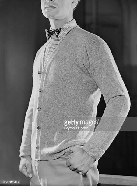 A model wearing a cardigan and a bow tieA fashion shoot for 'Harper's Bazaar' magazine circa 1949