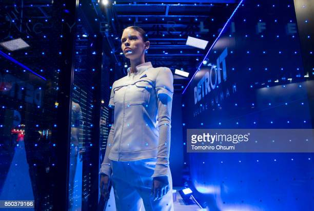 A model wearing a costume of an android character from the Detroit Become Human video game stands in the Sony Interactive Entertainment Inc booth...
