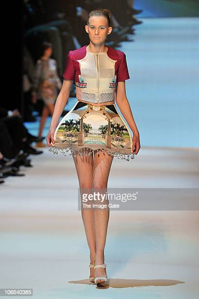 A model wearing a design by Mary Katrantzou winner of the Swiss Textiles Awards 2010 walks the runway during the second day of the Charles Vogele...