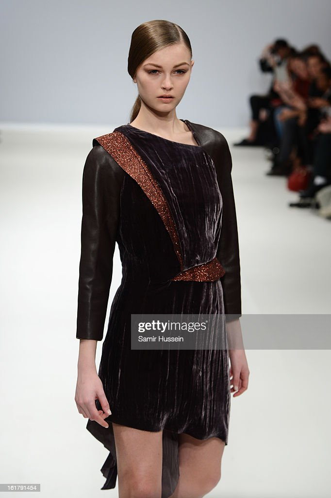A model wearing a design by Patrick Li walks the runway at the Ones To Watch show during London Fashion Week Fall/Winter 2013/14 at Freemasons Hall on February 16, 2013 in London, England.