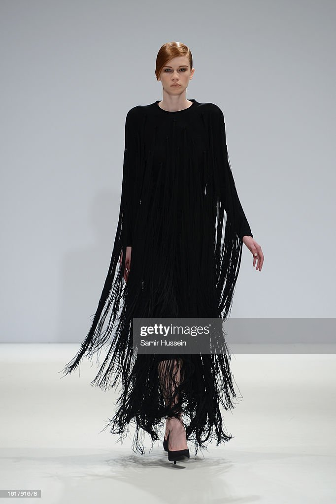 A model wearing a design by Yulia Kondanina walks the runway at the Ones To Watch show during London Fashion Week Fall/Winter 2013/14 at Freemasons Hall on February 16, 2013 in London, England.
