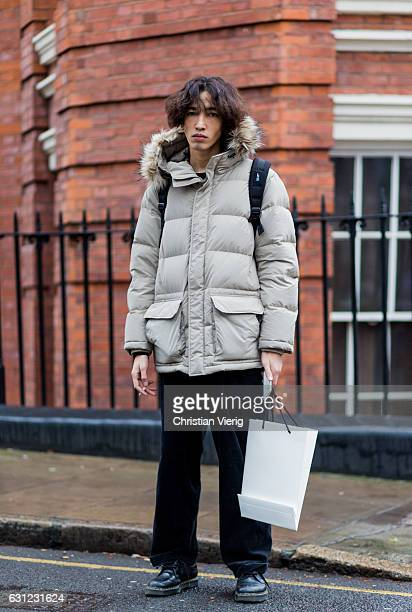 A model wearing a down feather jacket during London Fashion Week Men's January 2017 collections at JW Anderson on January 8 2017 in London England