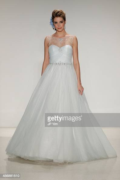 A model wearing a dress inspired by Disney character Cinderella from 'Cinderella' walks the runway wearing Disney Fairy Tale Weddings by Alfred...