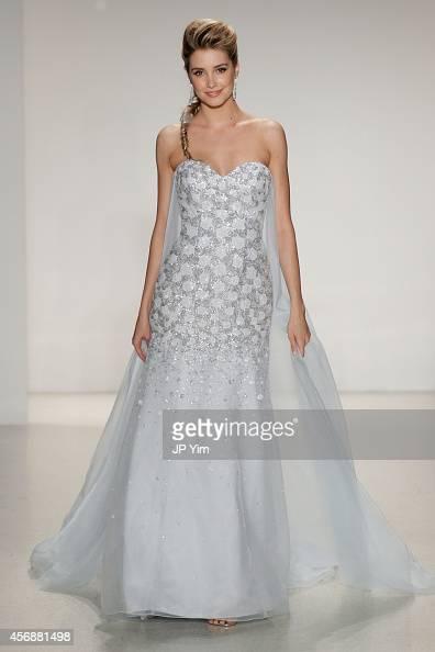 A model wearing a dress inspired by Disney character Elsa from 'Frozen' walks the runway wearing Disney Fairy Tale Weddings by Alfred Angelo...