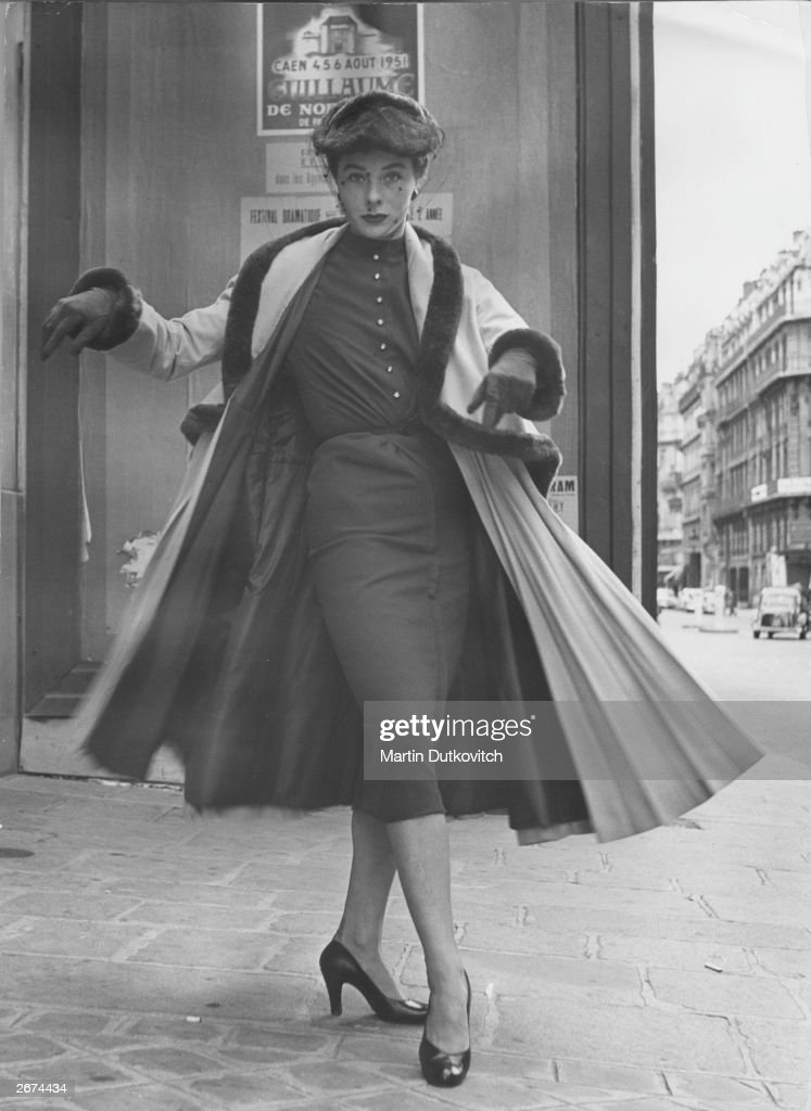 A model wearing a Jacques Fath 'bell-line' design in Paris. Original Publication: Picture Post - 5399 - Paris Springs No Surprises - pub. 1951