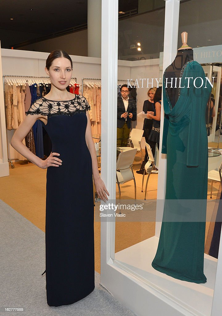 A model wearing a Kathy Hilton evening dress poses at Kathy Hilton Fall 2013 Collection Preview at the Coterie International Fashion Exhibition at Jacob Javitz Center on February 26, 2013 in New York City.