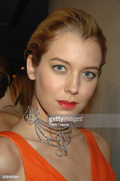 Model wearing a orange chiffon ruched front gown by Pamella Roland gothic glitz choker broach by Just Diamonds at the Academy Oscar�� Fashion Preview...