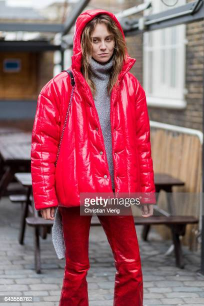 A model wearing a red flared pants red down feather jacket and a grey knit shirt outside Marques Almeida on day 5 of the London Fashion Week February...