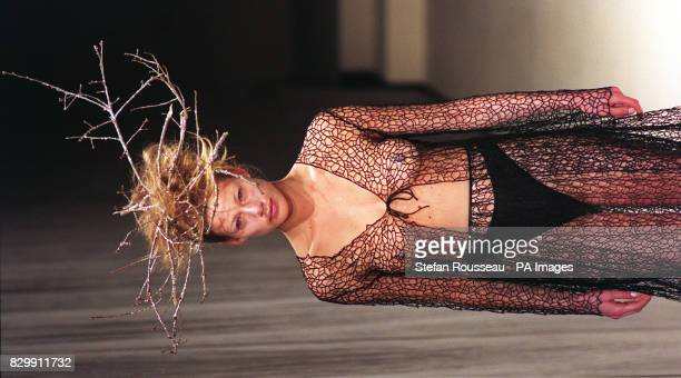 A model wearing a revealing black crochet skirt and threequarter length blouse/jacket by Maria Grachvogel on the second day of London Fashion Week...