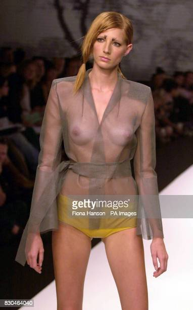 A model wearing a see through organza blouse with a sash belt by designers Boudicca at London Fashion Week Spring/Summer 2001