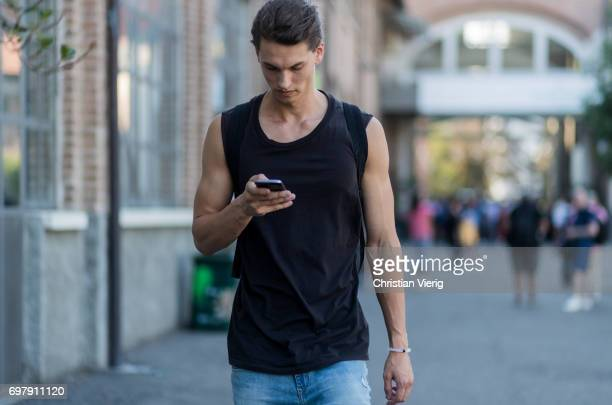 A model wearing a tank top is seen outside Malibu 1992 during Milan Men's Fashion Week Spring/Summer 2018 on June 19 2017 in Milan Italy