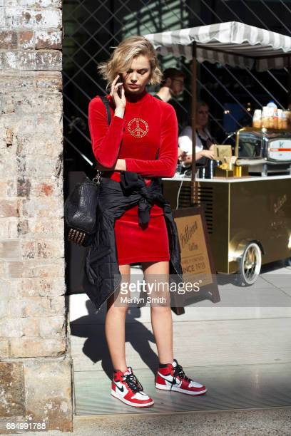 Model wearing a velvet dress Nike Air sneakers and a sequin detailed bomber jacket during MercedesBenz Fashion Week Resort 18 Collections at...
