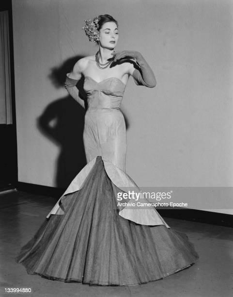 A model wearing a Veneziani di Milano evening dress in Cortina d'Ampezzo Italy 6th January 1951