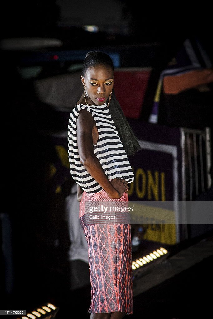 A model wearing an Adama Paris design at the Dakar Fashion Week on June 21, 2013, in Dakar, Senegal. Day three of the Dakar Fashion Week 2013 saw the first fashion show with the collection of Adama Paris, Virginie Ayissi, Bibas and Evgheni.