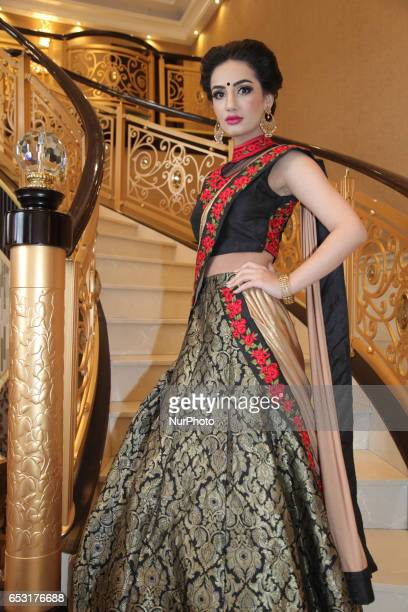 Model wearing an elegant and ornate bridal outfit during a South Asian bridal show held in Scarborough Ontario Canada
