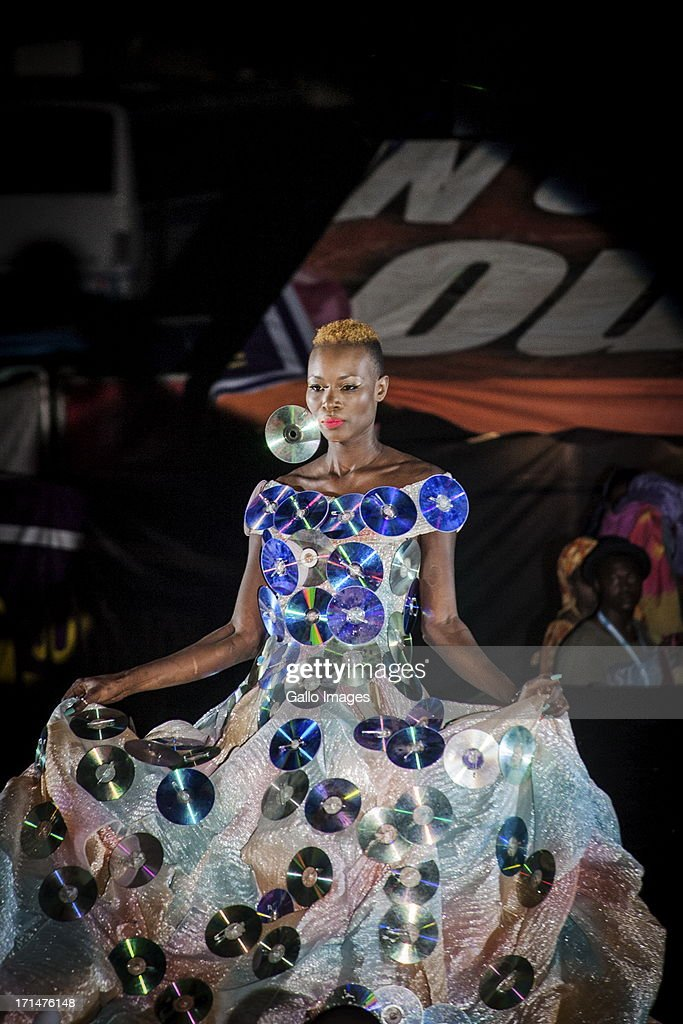 A model wearing an Oumou Sy design at the Dakar Fashion Week on June 21, 2013, in Dakar, Senegal. Day three of the Dakar Fashion Week 2013 saw the first fashion show with the collection of Adama Paris, Virginie Ayissi, Bibas and Evgheni.