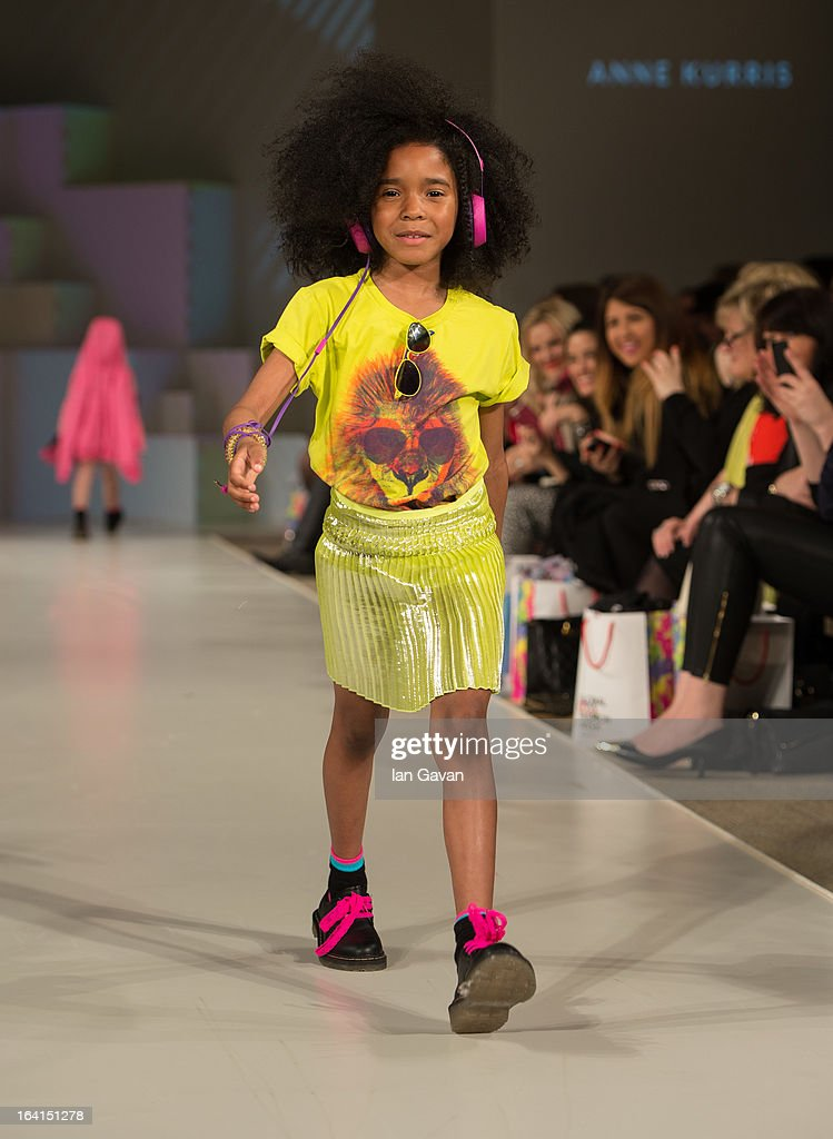 A model wearing Anne Kurris Spring/Summer '13 walks the runway at the Global Kids Fashion Week SS13 public show in aid of Kids Company at The Freemason's Hall on March 20, 2013 in London, England.