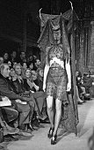 Model wearing antlers and a veil walks the runway at British fashion designer Alexander McQueen's first New York fashion show at a former synagogue...