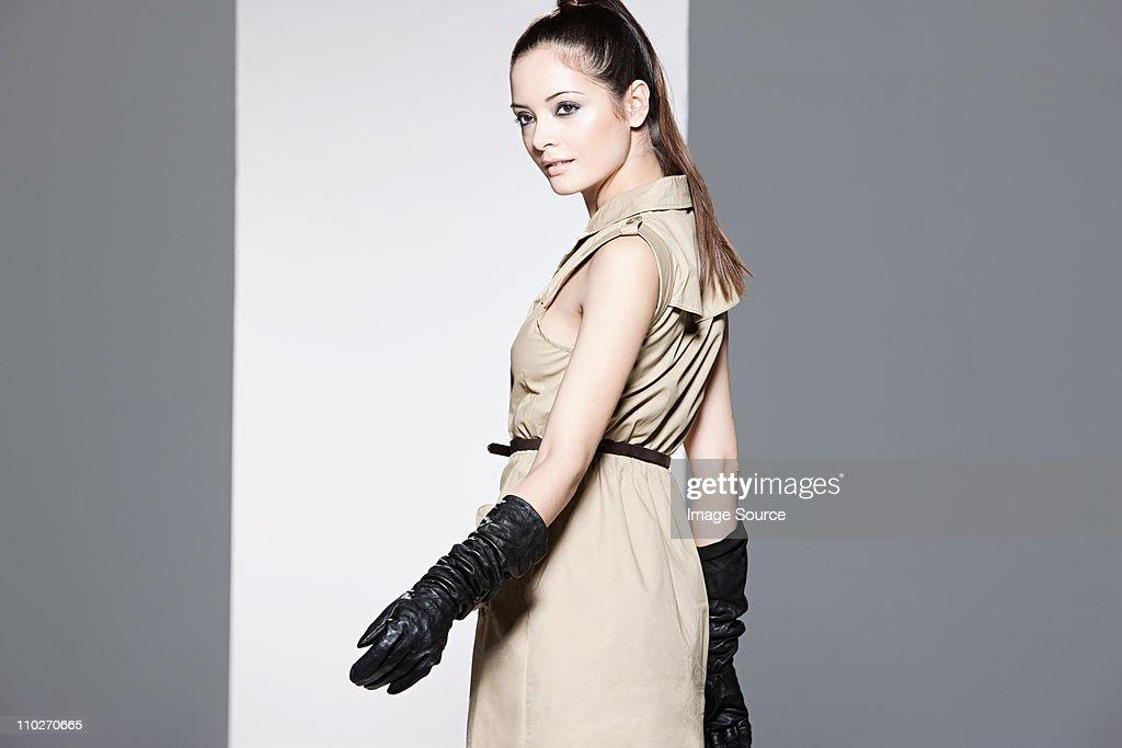 Model wearing beige dress on catwalk at fashion show : Stock Photo
