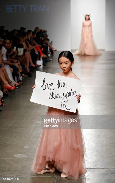 A model wearing Betty Tran walks the runway during the Fashion Palette Australia runway show during New York Fashion Week Spring 2015 at Pier 59 on...