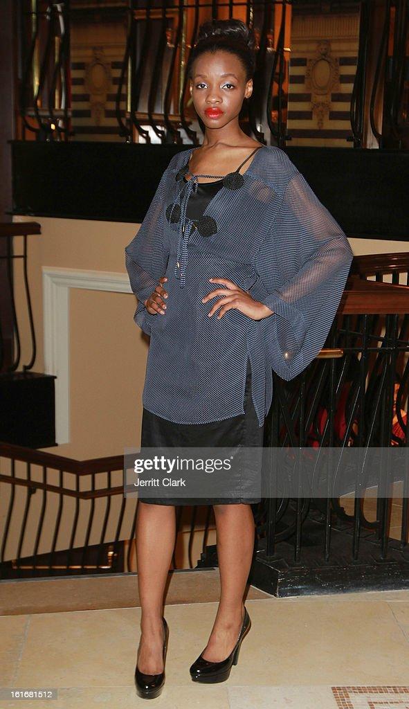 A Model wearing Callula Lilibelle by Melanie Fraser Hart walks in the Caravan Stylist Studio New York Presentation at the Carlton Hotel on February 12, 2013 in New York City.