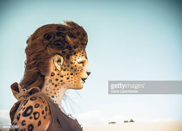 Model Wearing Cheetah Makeup Posing The Desert
