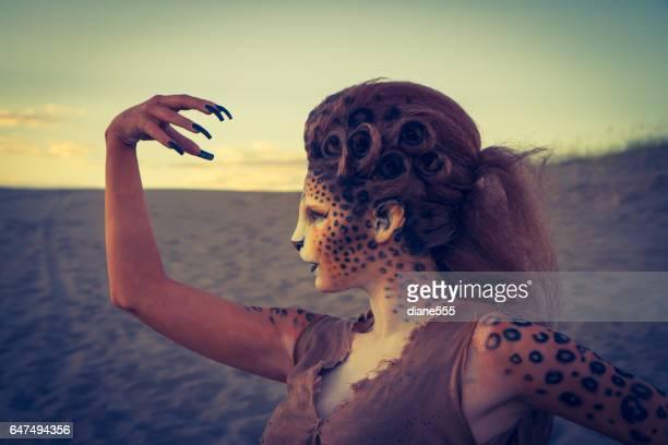 Model Wearing Cheetah Makeup Posing The Desert