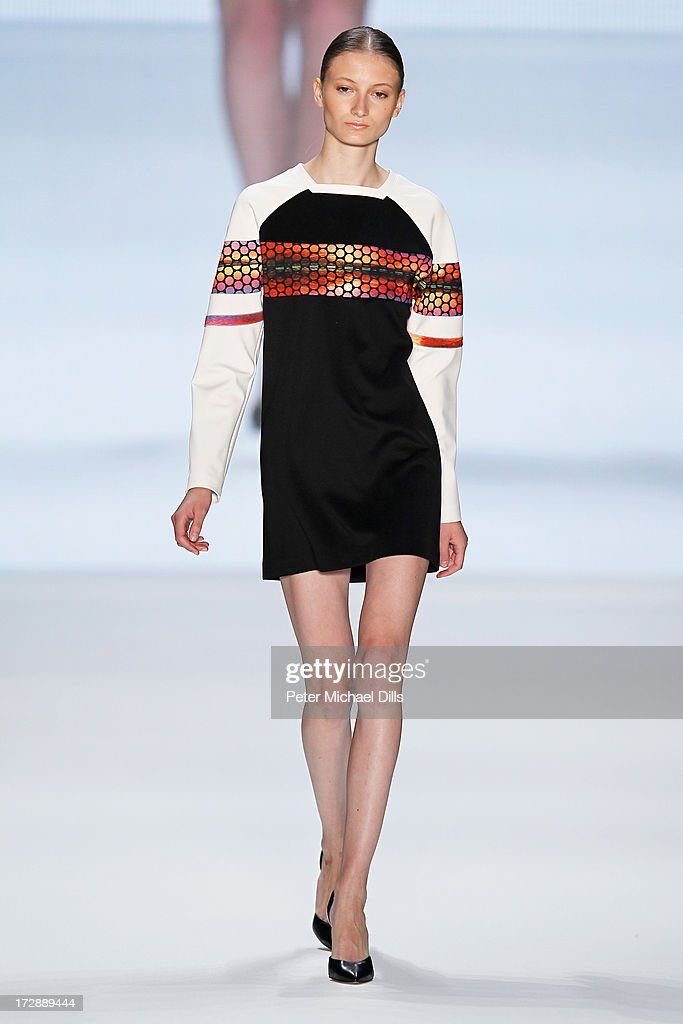 A model wearing clothes designed by Ece Goezen walks the runway at the Ece Goezen, Nazli Bozdag, Nevra Karaca No. 7 Show during Mercedes-Benz Fashion Week Spring/Summer 2014 at Brandenburg Gate on July 5, 2013 in Berlin, Germany.