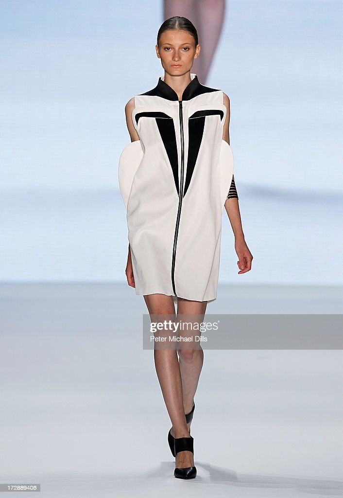 A model wearing clothes designed by Nevra Karaca walks the runway at the Ece Goezen, Nazli Bozdag, Nevra Karaca No. 7 Show during Mercedes-Benz Fashion Week Spring/Summer 2014 at Brandenburg Gate on July 5, 2013 in Berlin, Germany.